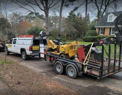 Cary-NC-Stump-Grinding-Job-Equipment-Parked-Outside