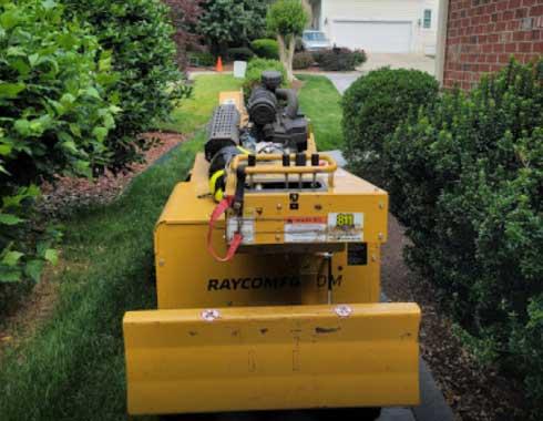 Raleigh-NC-Stump-Grinding-Job-Back-Yard-Equipment